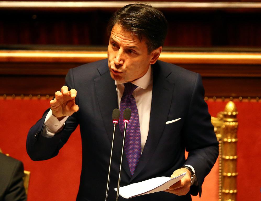 Премьер Италии выступил за пересмотр санкций в отношении РФ