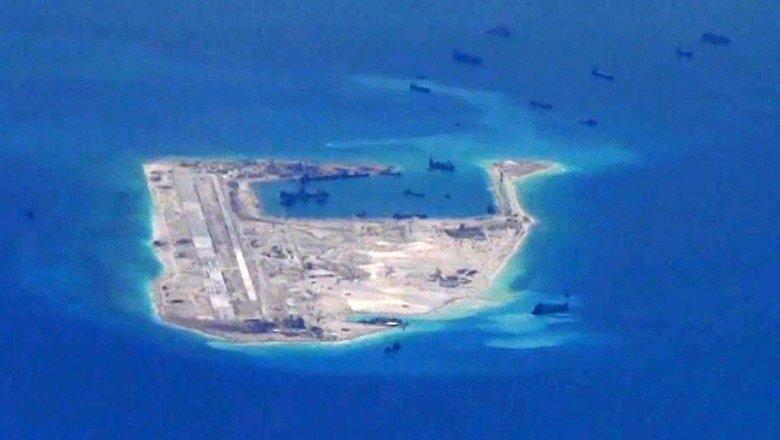 КНР недоволен инцидентом сзаходом американского эсминца вспорные воды