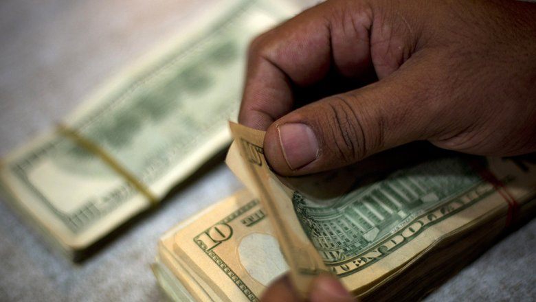 Официальный курс доллара вырос на17,9 копейки, евро— на8,46